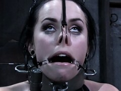 Alexa Von Tess in tight leather bondage and steel restraint