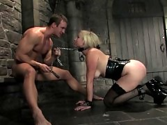 sex and bondage in a dungeon with girl in latex